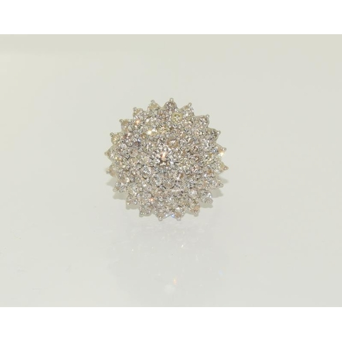 1390 - An 18ct white gold and diamond ladies cluster ring, Approx 3ct, Size R....