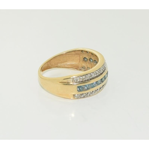 1371 - 14ct gold ladies blue diamond and white stone ring.  Size N+. 3.8g....