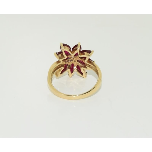 1394 - 9ct gold ladies ruby cluster ring. Size N+....