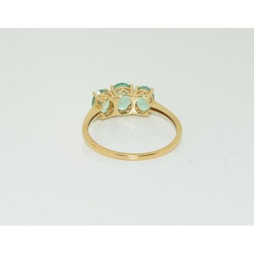 1368 - 14ct gold ladies Zambian emerald trilogy ring. Size W+....