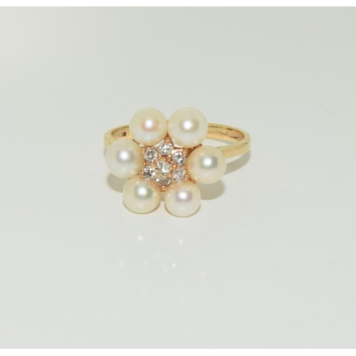 1365 - 14ct gold pearl and diamond ring. Size N....