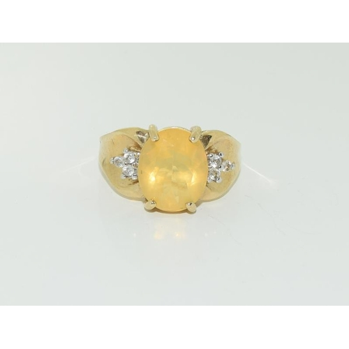 1373 - 9ct gold Ethiopian opal ring. Size N+....