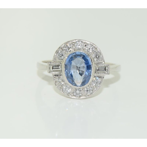 1386 - Platinum ladies sapphire and diamond ring. Size N....
