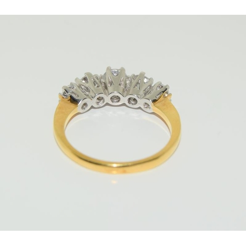 1366 - 9ct gold on silver 5 stone CZ ring. Size M...