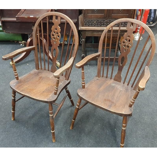 1472 - Set of six wheel back oak dining chairs to include carvers....