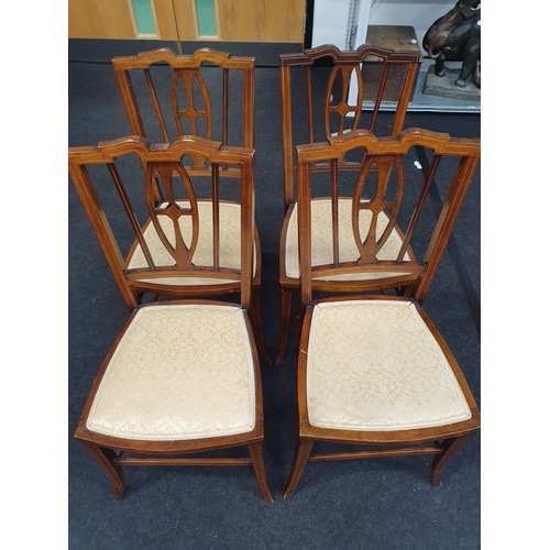 1407 - A set of four Edwardian inlaid mahogany parlour chairs....