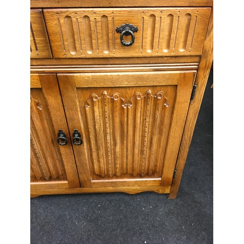 1426 - An Old Charm linen fold dresser of small proportions....