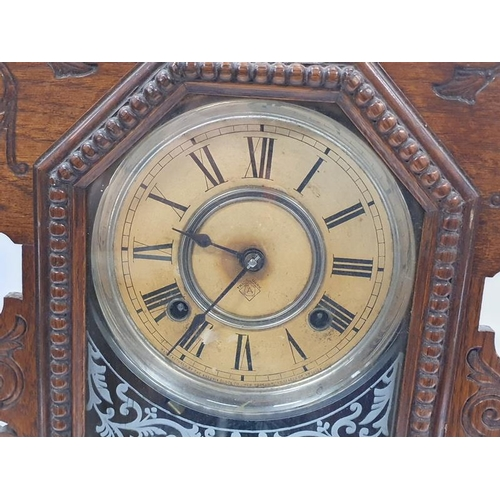 1358 - An American oak cased bracket clock by the Ansonia Clock Co. New York....