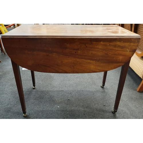 1406 - A mahogany single drawer Pembroke table on brass castors....