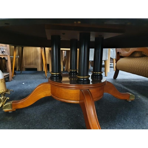 1437 - Mahogany inlaid coffee table on brass castors with bird cage pillar support....