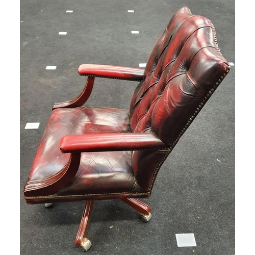 1438 - Leather Chesterfield office chair on castors....