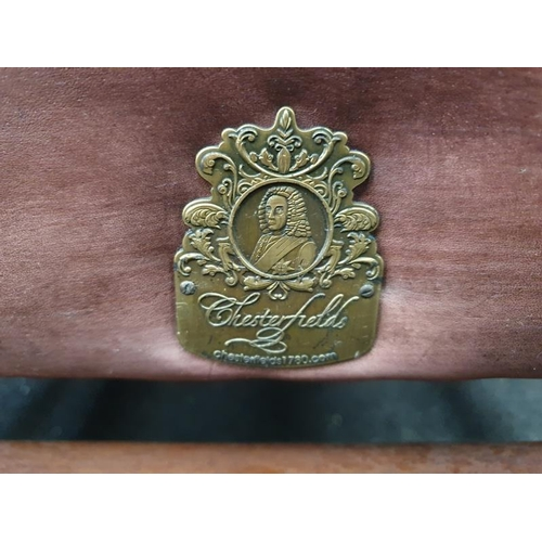 1439 - Wing back leather Chesterfield armchair with Chesterfield badge....