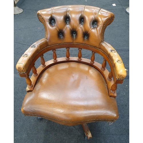 1441 - Bucket back modern leather office swivel chair on castors....
