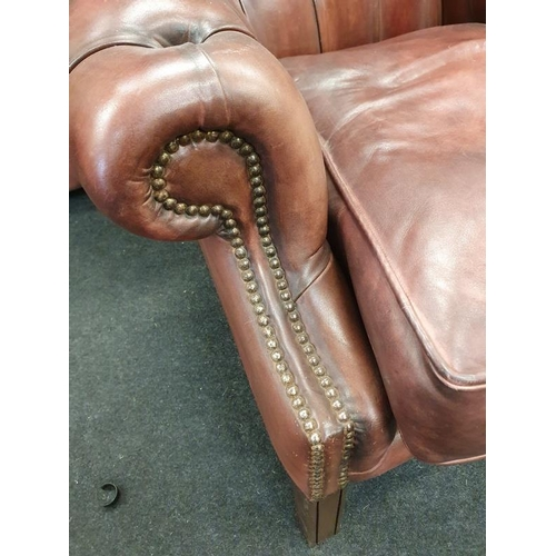 1442 - Wing back leather Chesterfield armchair with Chesterfield badge....