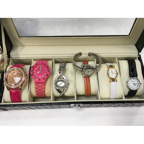 1214 - Three display cases containing ladies watches.