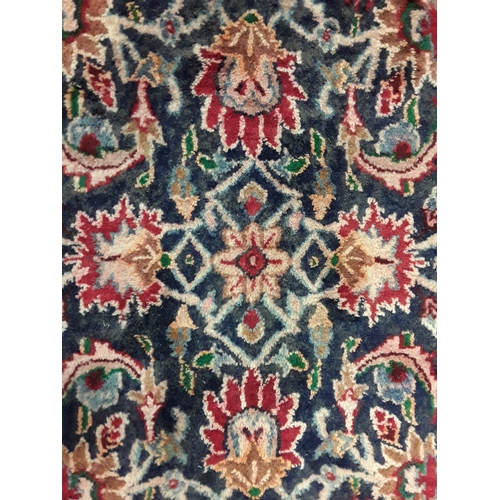 1430 - Handmade woollen Hamadan carpet with central repeated floral design in blue and cream Palmette guard...