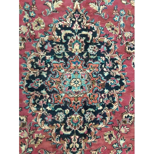 1445 - Handmade woollen Mashad carpet, central medallion in blue link with red floral, guard repeated with ...