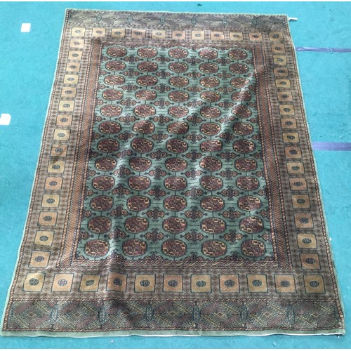 1454 - Large green patterned carpet. 275 x 190cm....