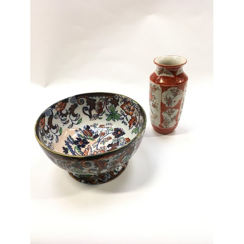 35 - An Oriental bowl together with an Oriental vase....