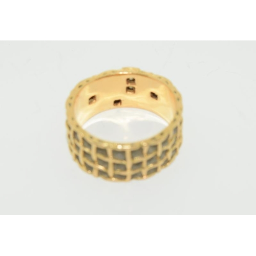 1360A - 18ct gold gents signet ring. Full band of cut and polished diamonds size V....