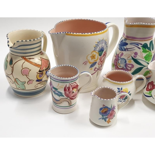 472 - Poole Pottery x 8 Traditional pattern jugs to include 1930's Gwen Haskins....