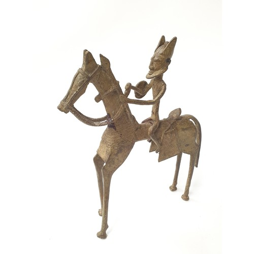 10A - Bronze Egyptian statue of a man on horseback....