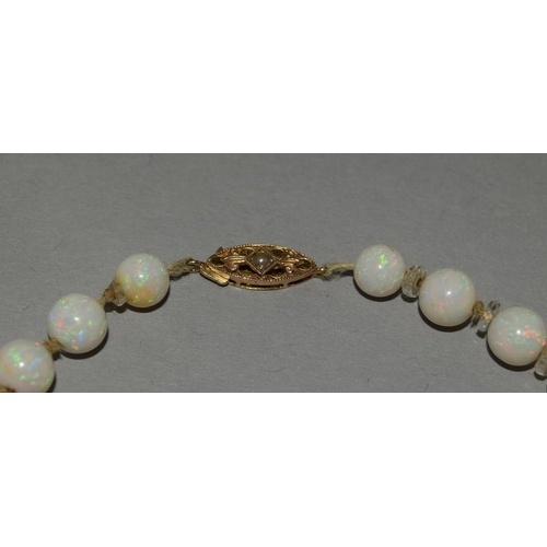 138 - A Strand of Antique Natural Opal Beads. Measuring from 6mm to 9mm in Diameter. Rock Crystal Rondelle...