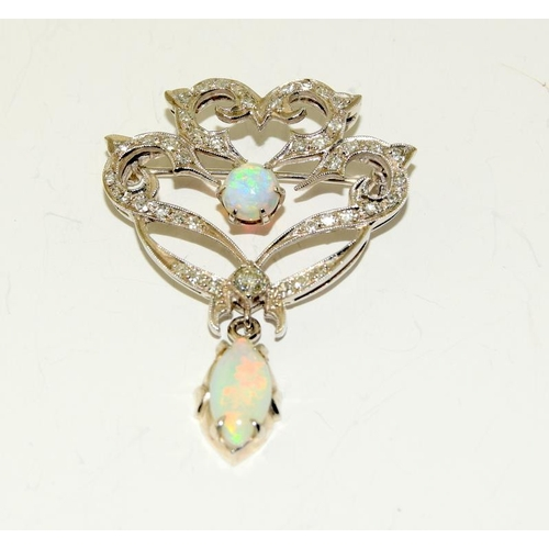 136 - Tested as 18ct White Gold 4.2cms x 3.2cms Opal and Diamond Art Nouveau style brooch pin, 7.8grams....