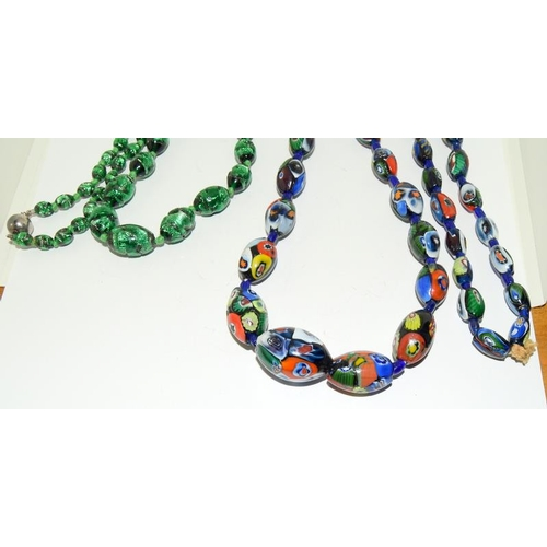 172 - A Large strand of Antique Venetian Millifiori Large Beads with a long strand of green foiled beads....