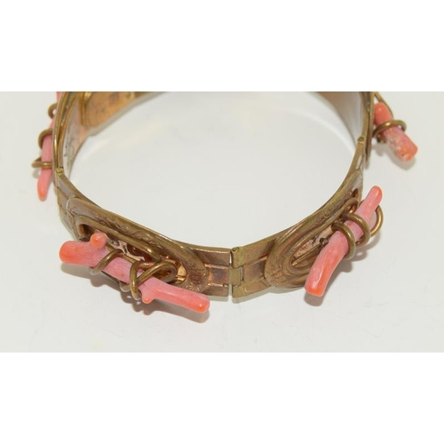 21 - An Antique Sprig Coral Bracelet with a Coral & mother of Pearl Brooch.