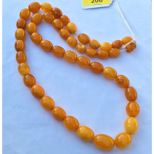 206 - A Strand of Vintage Baltic Butterscotch Yellow Amber Beads. Weight 72g. Beads 15mm - 22mm.