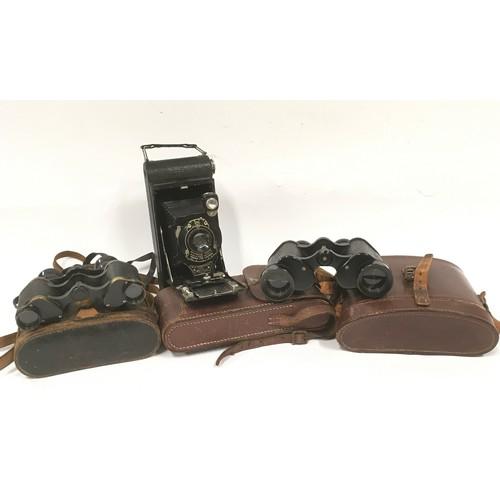 34 - Voiglander 6x21 binoculars vintage ,Kodak no1 pocket camera and cased possibly military no2 mk1 bino...