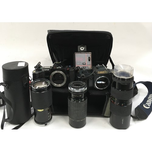 36 - Collection of various cameras and lenses to included Canon,Olympus etc...