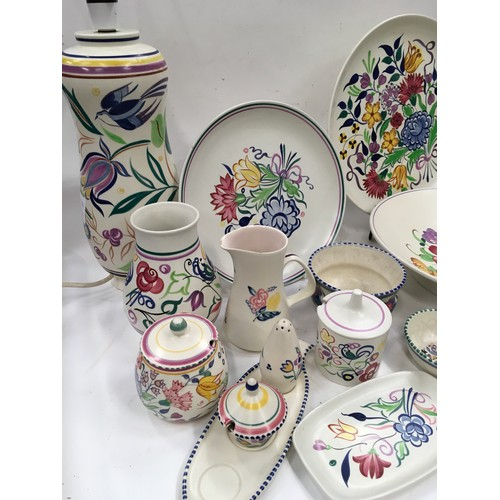 38 - Large collection of vintage Poole pottery items including lamps...