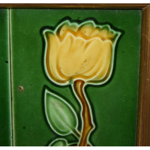 87 - Framed pair of relief moulded Art Nouveau edging tiles depicting yellow flowers with a green backgro...