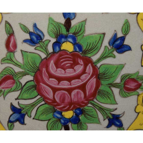 285 - Late 19th/early 20th C Persian hand painted coloured tile, 7.6