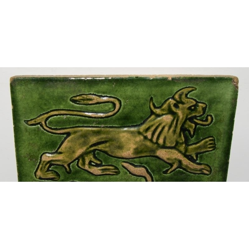 346 - William De Morgan & Co, Sands End Pottery, Fulham earthernware tile with green glaze depicting a