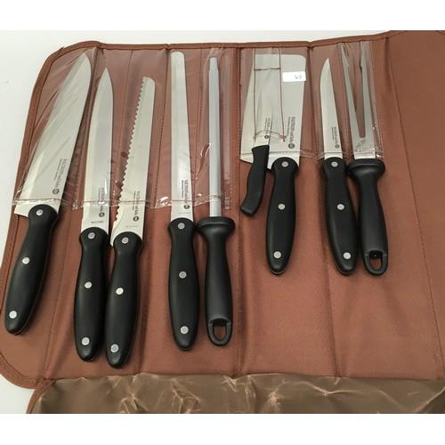 25 - A 9 piece knife set (ref 64)...