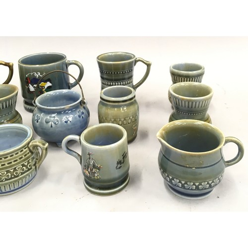 47 - A quantity of Wade miniatures to include mugs, jugs etc....