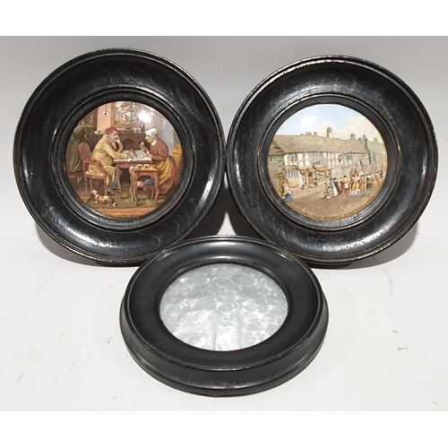 3 - A pair of Victorian ceramic pot lids in oak frames together with another fabric pot lid....