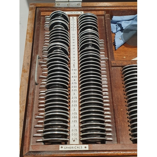 6 - A wooden case containing a collection of opticians eye glasses....