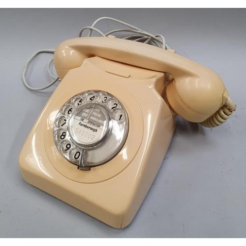 19 - A pair of vintage dial telephones.