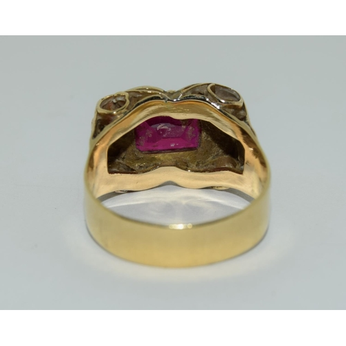 21 - Yellow metal ruby gents signet ring.