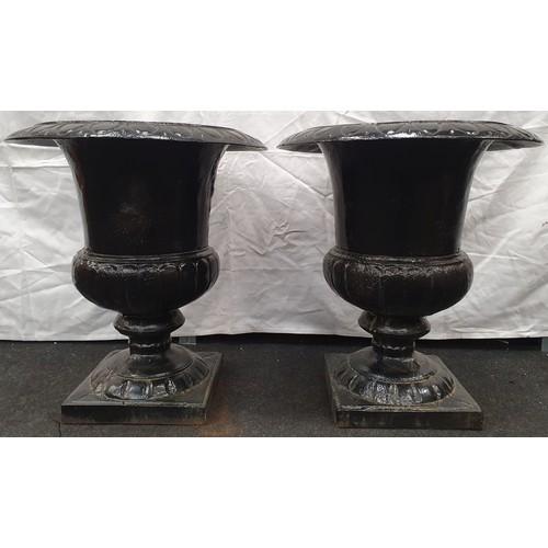 3 - A pair of black painted cast iron Griechen style garden urns 59cm high 52cm diameter.