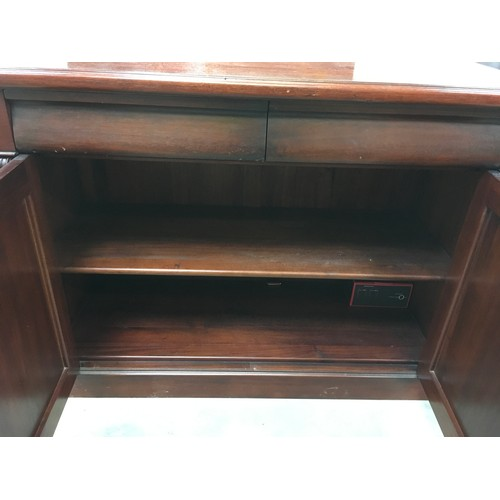 26 - Mahogany hallway cupboard with two drawers above double cupboard decorative carved mounts to front 1...
