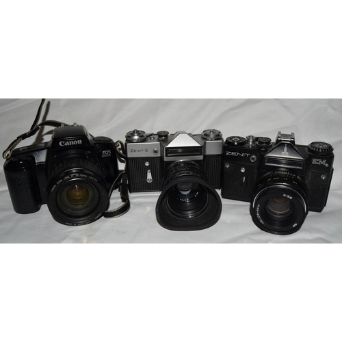 47 - Collection of vintage 35mm flim SLR cameras and associated lenses.