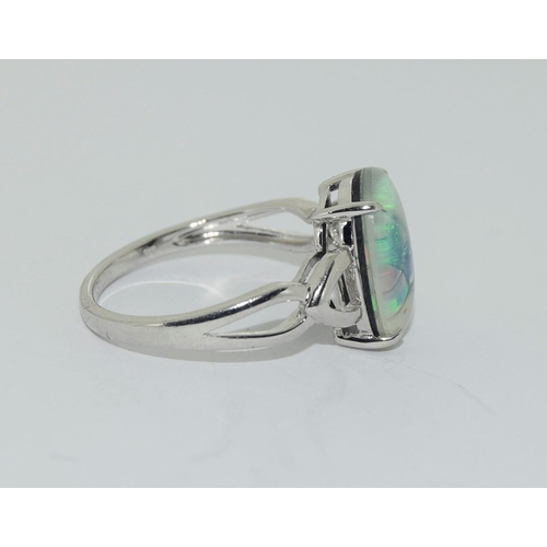 133 - Silver ladies ring set with a glassed marble finish. Size R.
