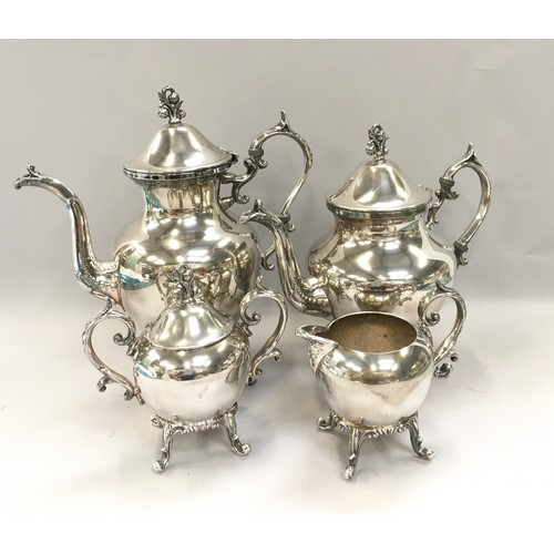 10 - Silver plated 4 piece teaset together a silver plate butlers tray and a claret jug