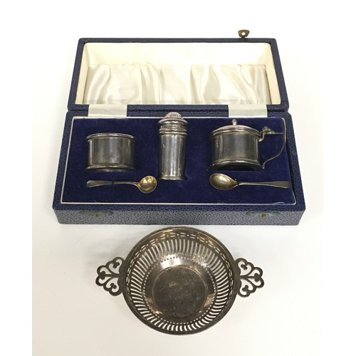 14 - Sterling silver condiment set boxed together a pierced small silver twin handled bowl