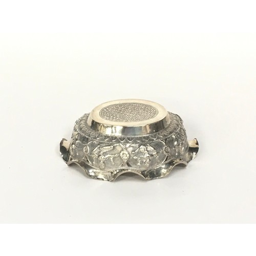 17 - Oriental silver embossed  double prow bowl together a embossed small silver bowl 190gm